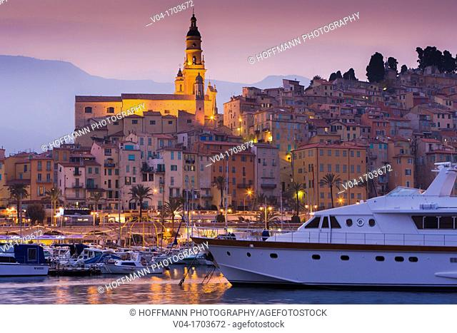 Harbor and the Basilique St-Michel-Archange in Menton at dusk, Provence, France, Europe