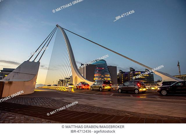 Cars on Samuel Beckett Bridge, cable-stayed bridge and swing bridge over the river Liffey, architect Santiago Calatrava, Dublin, Republic of Ireland