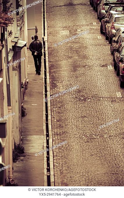 Man walking on a hilly narrow street in Montmartre