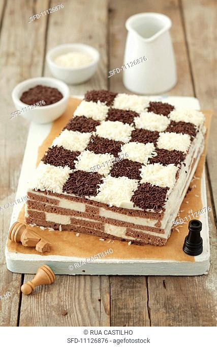 A chessboard cake coconut and chocolate sponge cake