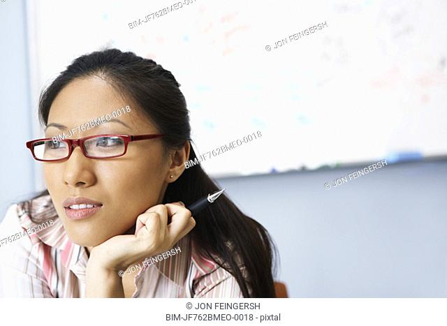 Portrait of Asian businesswoman in front of whiteboard