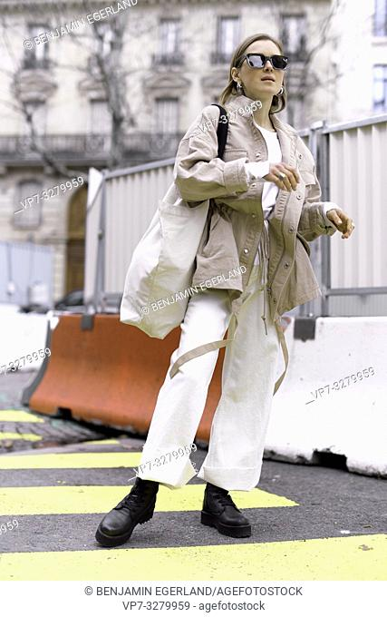 fashionable woman at street during fashion week, in Paris, France