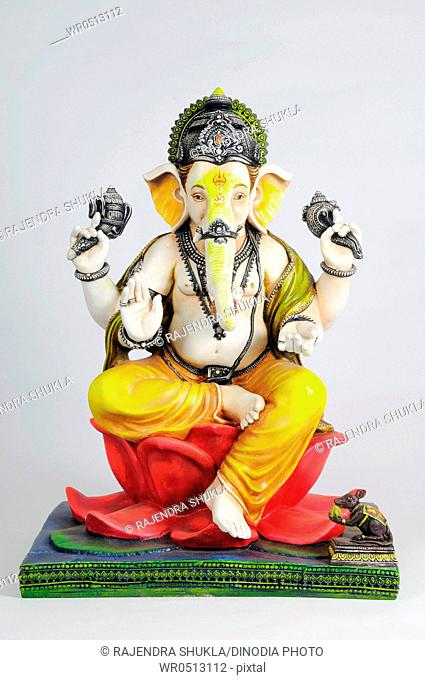 Statue of lord ganesh sitting on lotus , India