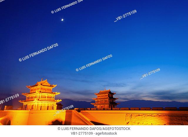Jiayuguan fort illuminated at twilight at the western boundary of the Great Wall of China. The pass was a key waypoint of the ancient Silk Road