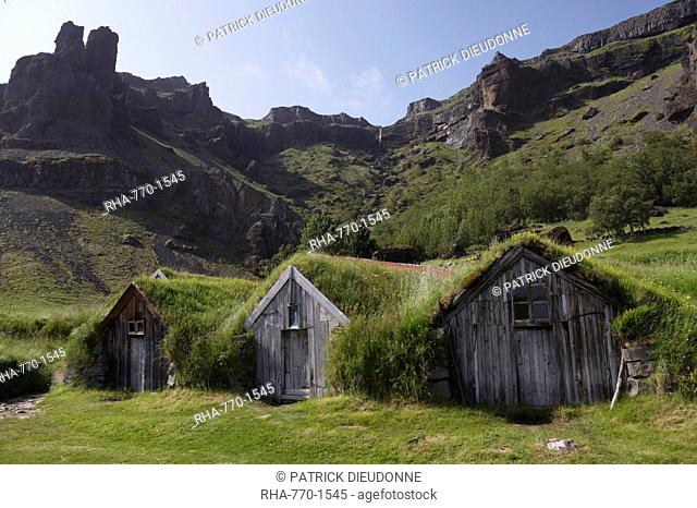 Farm buildings dating from the 18th and 19th centuries at Nupsstadur, under Lomagnupur cliffs, South Iceland, Iceland, Polar Regions