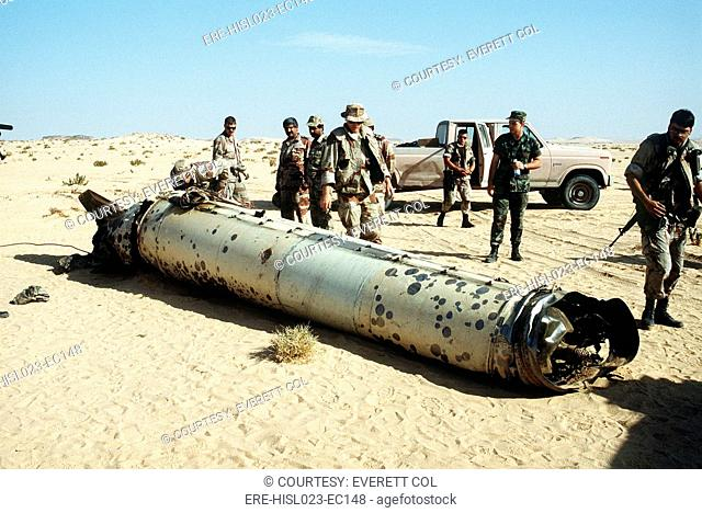 Military personnel examine a Scud missile shot down by an Patriot air defense missile during Operation Desert Storm. May 26 1992. BSLOC-2011-3-36