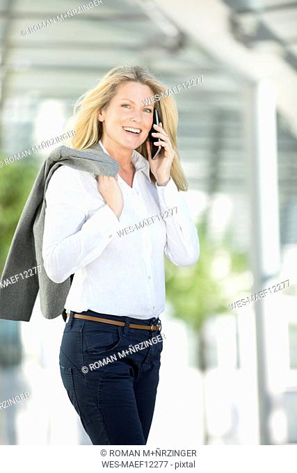 Successful businesswoman using smartphone