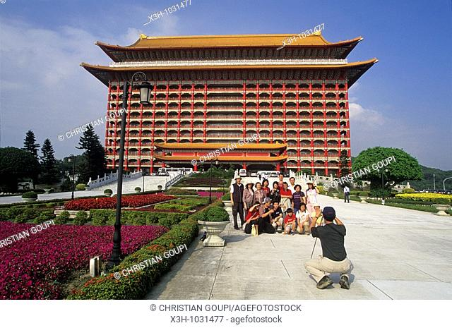 group of tourists in front of The Grand Hotel built in 1952 by Chiang Kai-shek to accommodate foreign ambassadors in Taipei,Taiwan also known as Formosa