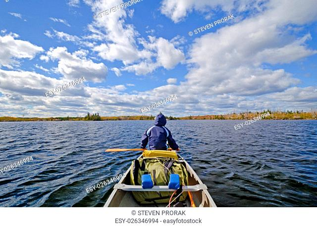 Canoer on Seagull Lake in the Boundary Waters in Fall