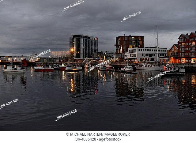 Harbour basin with boats and hotel buildings on the shore at twilight, Svolvær, Lofoten, Nordland, Norway