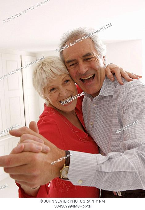 Senior couple dancing and laughing