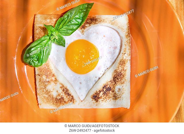 breakfast of toast and eggs in the shape of heart