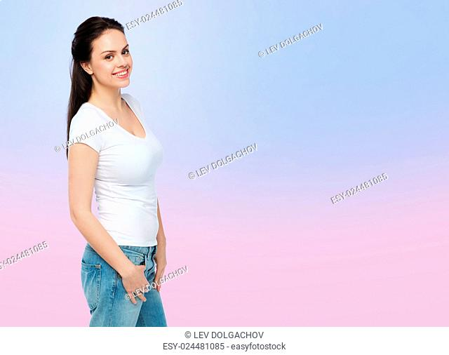 advertisement, clothing and people concept - happy smiling young woman or teenage girl in white t-shirt over rose quartz and serenity gradient background