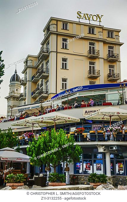 The Savoy hotel behind a new multi-tier shopping center on the waterfront in Opatija, Croatia
