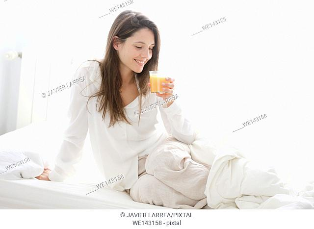 Young woman with fruit juice