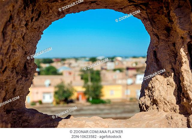 View over Khiva old town through city wall hole, Uzbekistan