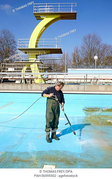 A staff member cleans the pool of the the public Open air pool in Koblenz, Germany, 11 March 2015. Open air pools are preapring for the forthcoming spring and...