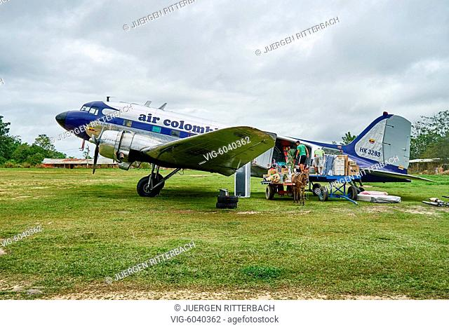 COLOMBIA, LA MACARENA, 19.08.2017, old Douglas DC-3 propeller plane loaded from donkey carriage , Serrania de la Macarena, La Macarena, Colombia