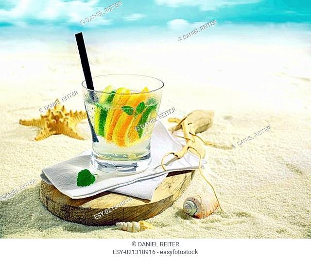 Gin or vodka cocktail on a tropical beach