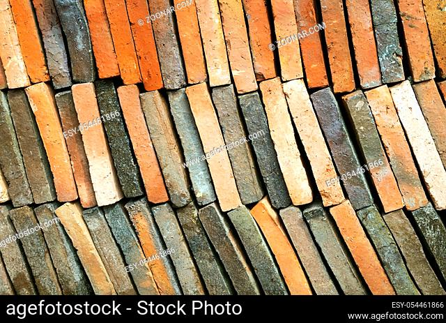 Background of old clay tiles in a pile for roof construction