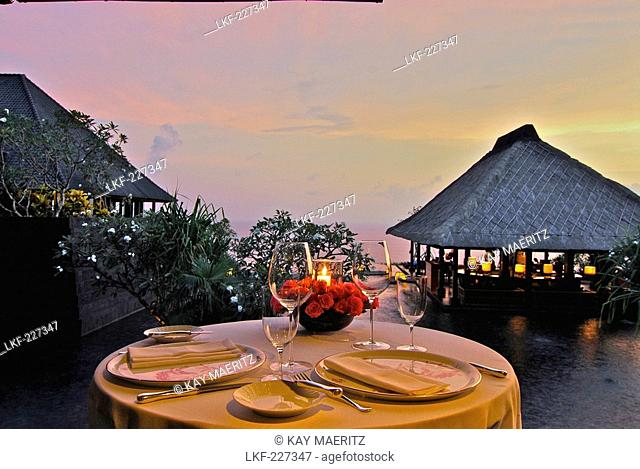 A table is laid at the restaurant at Bulgari Resort in teh evening, Bukit Badung, Southern Bali, Indonesia, Asia