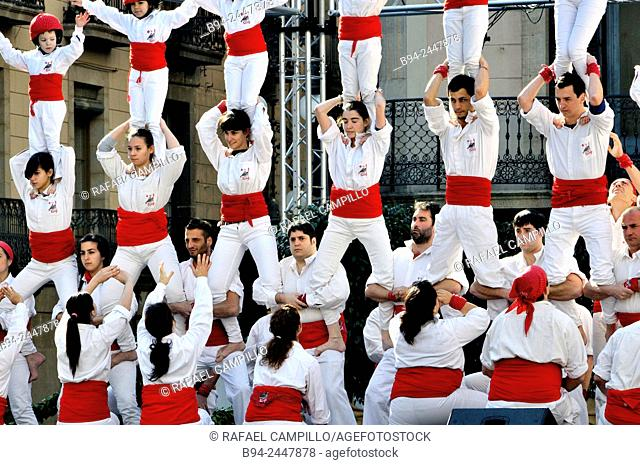 Castell, human towers. February 12, Falcons group. Celebration of Saint Eulalia martyr, 290-303 AD. Canonized 633 AD. Copatron of Barcelona
