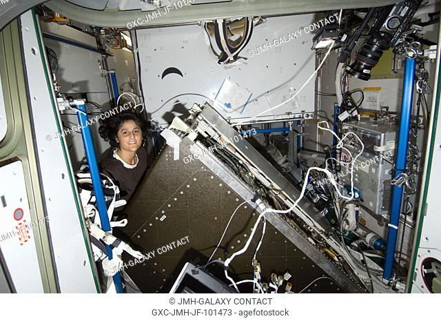 NASA astronaut Sunita Williams, Expedition 33 commander, conducts the continuing preventive inspection and cleaning of accessible Atmosphere Revitalization (AR)...