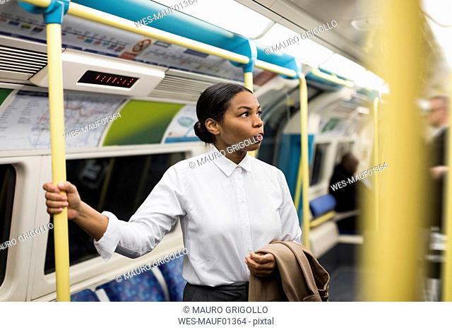 UK, London, portrait of businesswoman in underground train