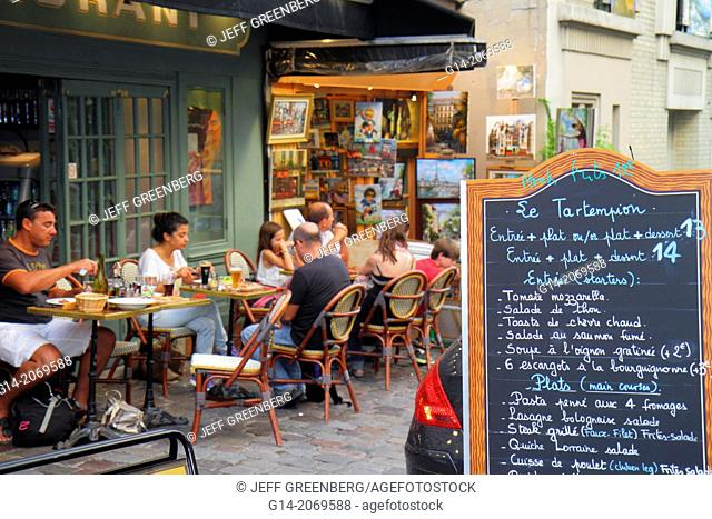 France, Europe, French, Paris, 18th arrondissement, Montmatre, Place du Tertre, restaurant, cafe, brasserie, tables, chairs, customers, alfresco, menu