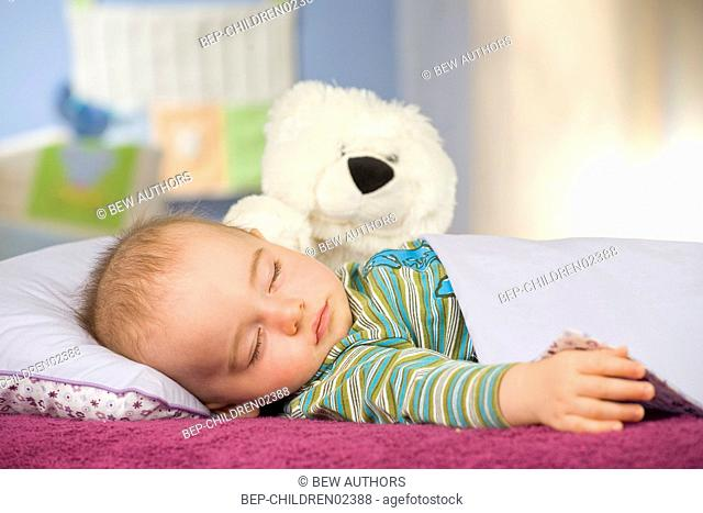 Portrait of a sleeping baby in bed