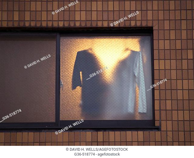 Clothes hanging in an partment window in Tokyo, Japan