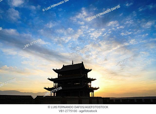 Jiayuguan fort at dusk at the western boundary of the Great Wall of China, Gansu province, China, Asia The pass was a key waypoint of the ancient Silk Road