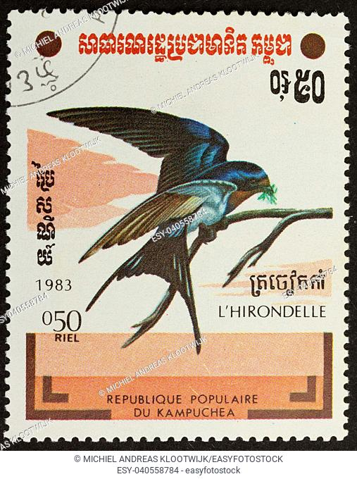 CAMBODIA - 1983: Stamp printed in Cambodia shows a swallow, 1983