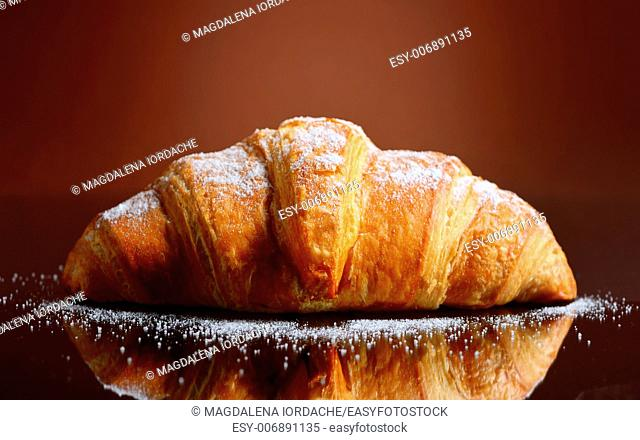 Fresh and tasty croissant with butter