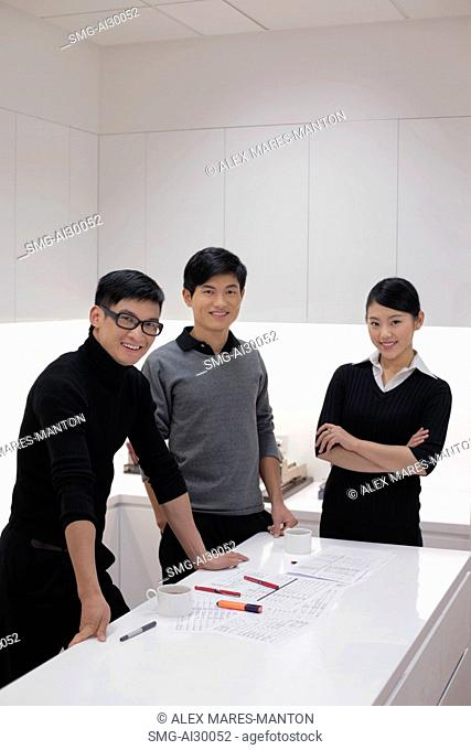 Three people working together in modern office