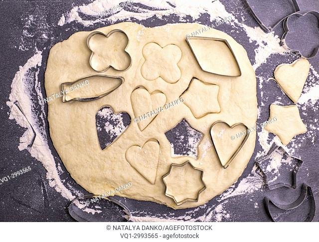 cut out from the dough shape for baking cookies, top view