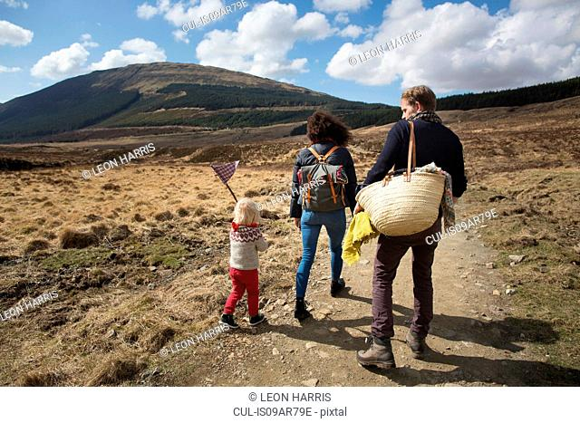Family hiking on path in hills, Fairy Pools, Isle of Skye, Hebrides, Scotland