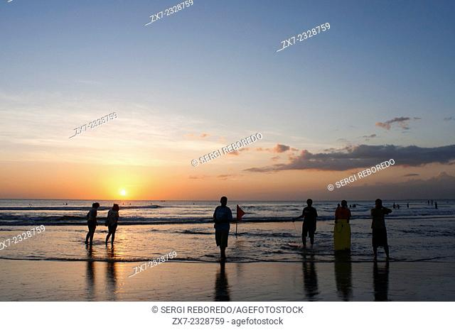 Surfers on the beach of Kuta. Surfing lessons. Bali. Kuta is a coastal town in the south of the island of Lombok in Indonesia