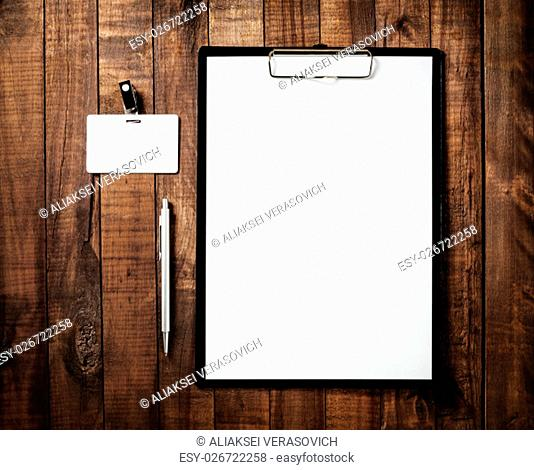 Blank branding mock-up. Blank letterhead, badge and pen. Blank ID template on vintage wooden table background. Branding template for design portfolios