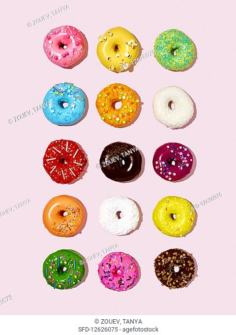 Lots of colourful glazed doughnuts