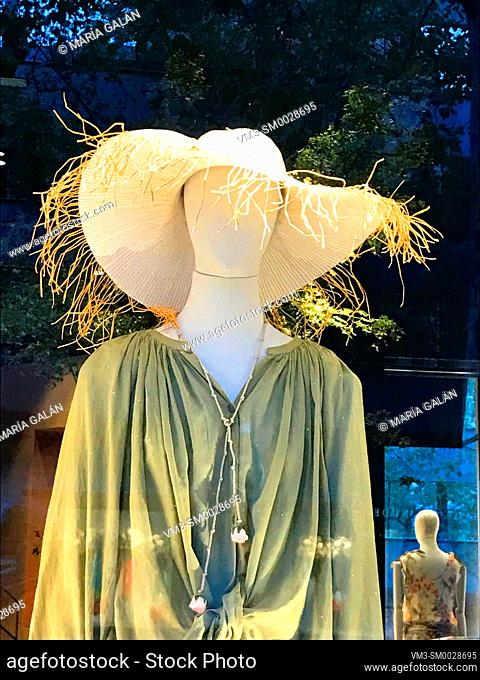 Mannequin wearing sun hat in a shop window. Madrid, Spain