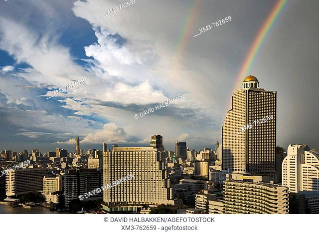 Double rainbow over Bangkok, Thailand. The Shangri La hotel on the Chao Phraya river is in the middle foreground. The Oriental hotel is to the left of the...