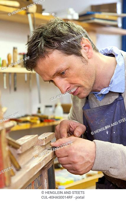 Carpenter working in shop