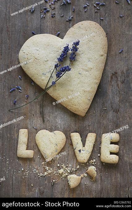 A heart-shaped, gluten-free shortbread biscuit with lavender and the word 'Love'