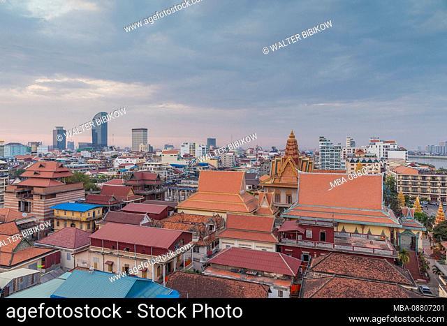 Cambodia, Phnom Penh, elevated skyine along Tonle Sap River, dusk