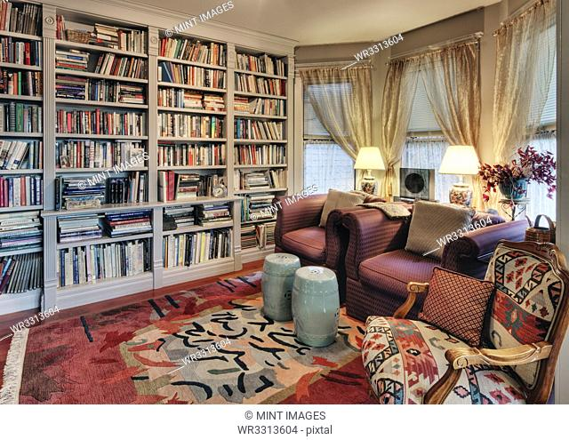 Armchairs and bookcases in living room