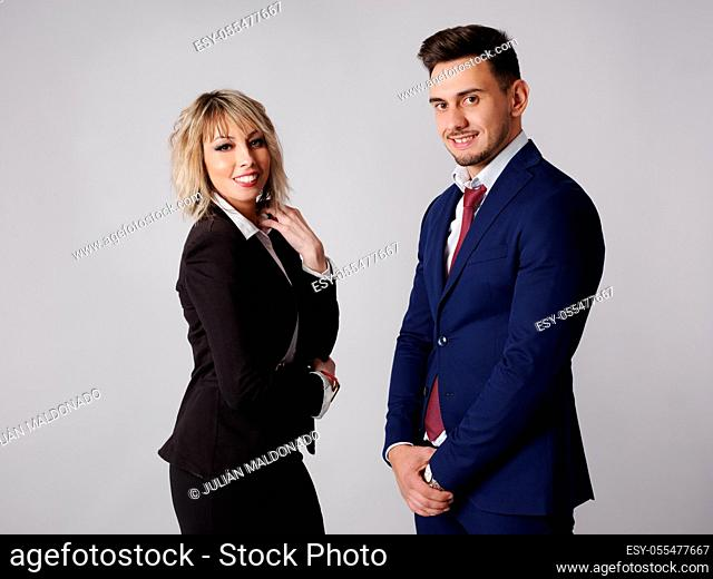 Business personnel are shown smiling and with positive and confident aptitude