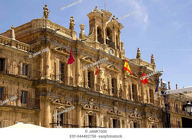 Flags on the facade of the main gate of the historical Plaza Mayor square in Salamanca, Spain