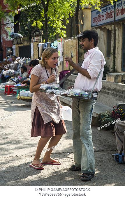 Exchange between a female tourist and a street vendor, Rishikesh, India