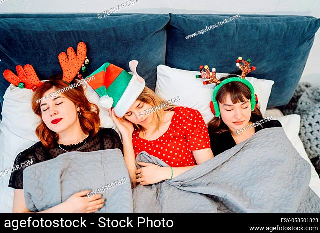 Gorgeous Female Models Sleeping After Pajamas Party In Light Home Interior
